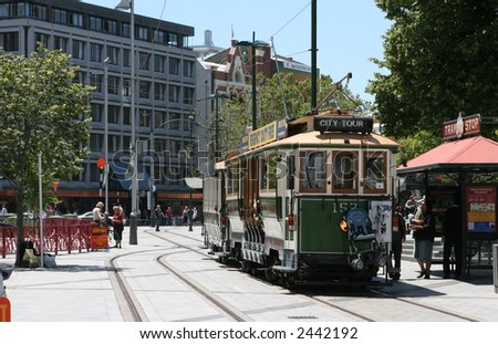 Restored Tram in Christchurch's Cathedral Square, New Zealand. - stock photo