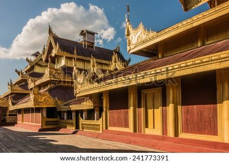 Restored wooden buildings at Mandalay Palace - stock photo
