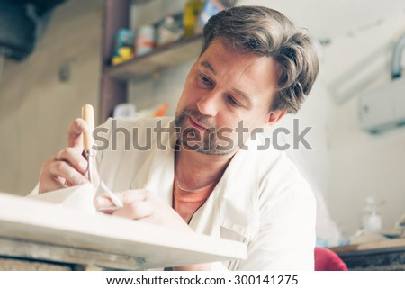 restorer making his work - stock photo