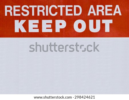 Restricted area keep out sign painted on board - stock photo