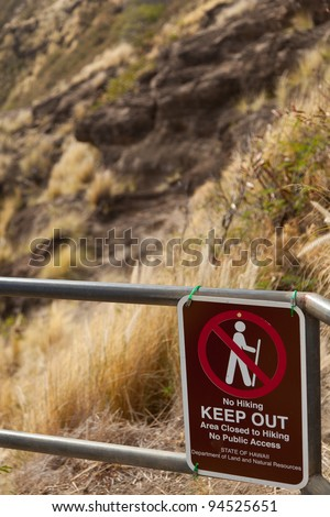 Restricted hiking sign in interior of Diamond Head crater in Waikiki Hawaii - stock photo