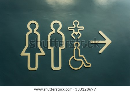 Restroom Sign on the cemen background. - stock photo