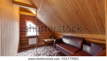 restroom with a pole and a sofa in the wooden house
