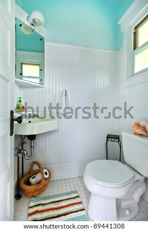 Restroom with toilet and sink - antique. - stock photo