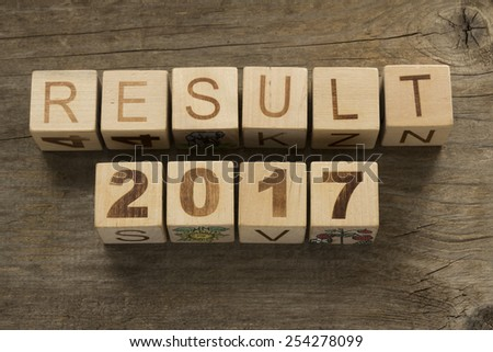 Result 2017 on a wooden background - stock photo