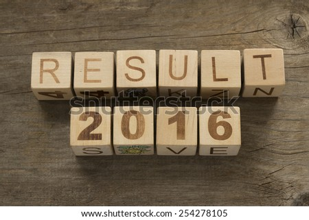 Result 2016 on a wooden background - stock photo