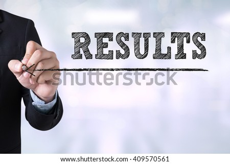 RESULTS  Concept Businessman drawing Landing Page on blurred abstract background - stock photo
