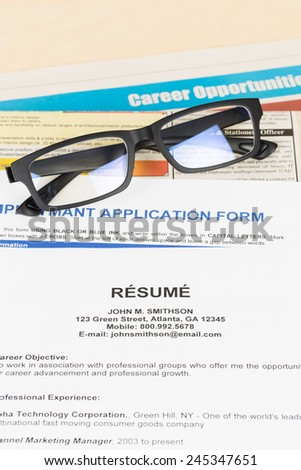 Resume and glasses on classify newspaper concept job applying - stock photo