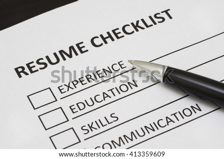 Resume checklist with a pen - stock photo