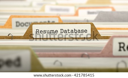 resume database concept colored document folders sorted for catalog closeup view selective focus