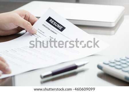 Resume information with pen calculator and laptop computer with business man in the office.