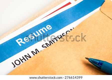 Resume letter background in brown envelop and pen, can use as recruitment business concept - stock photo
