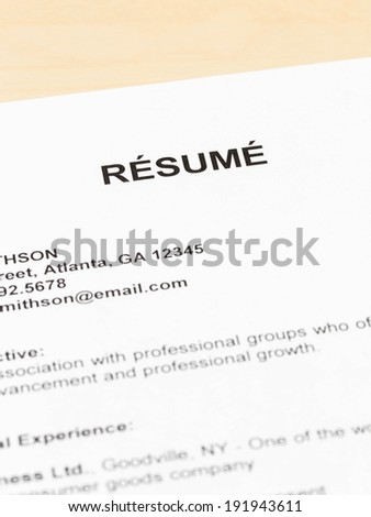 Resume on table closeup concept for employment - stock photo