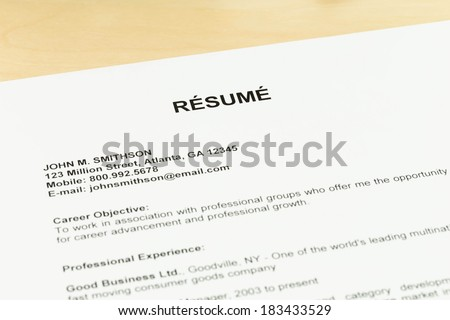 Resume on table closeup job applying concept - stock photo