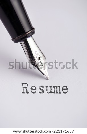 Resume with pen written on paper  - stock photo