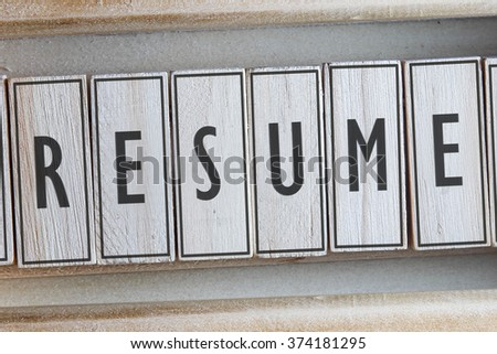 RESUME word on wood blocks concept - stock photo