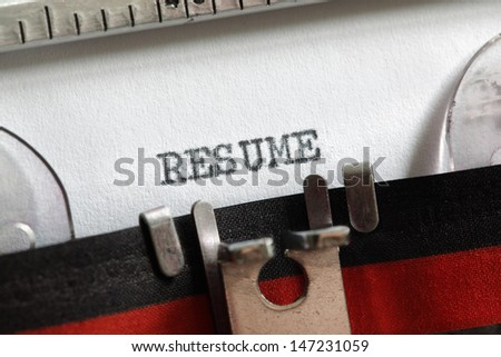 Resume written on an old typewriter concept for job search and recruitment - stock photo