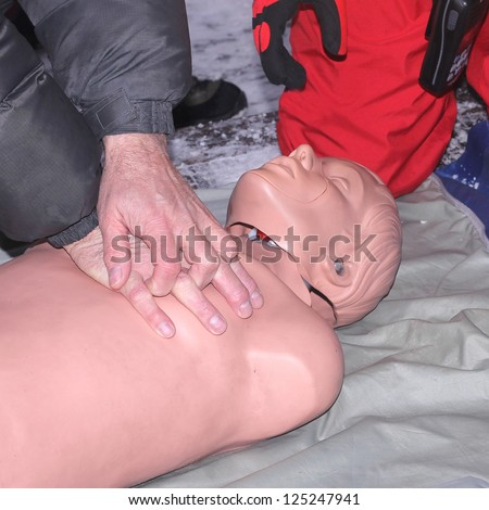 Resuscitation training using first-aid dummy - stock photo