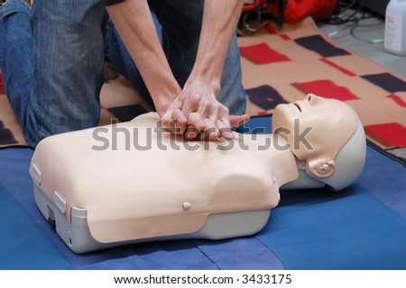 Resuscitation training using first-aid dummy - stock photo