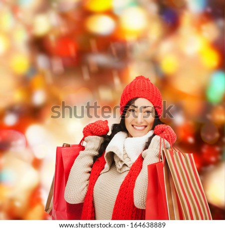 retail and sale concept - happy woman in winter clothes with shopping bags - stock photo