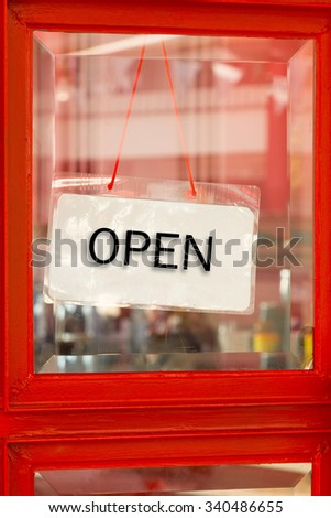 Retail and shopping image of an open sign on restaurant door - stock photo