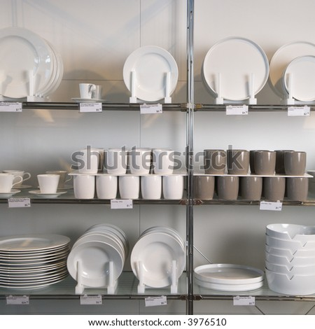 Retail display of porcelain dishes and mugs.