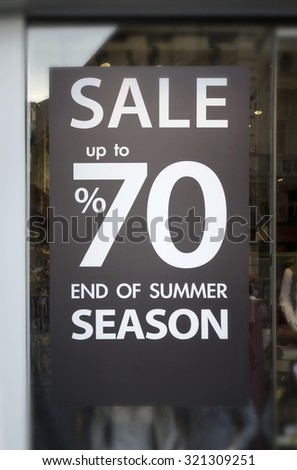 Retail Image Of A Sale Sign In A Clothing Store Window (With Shallow DoF) - stock photo