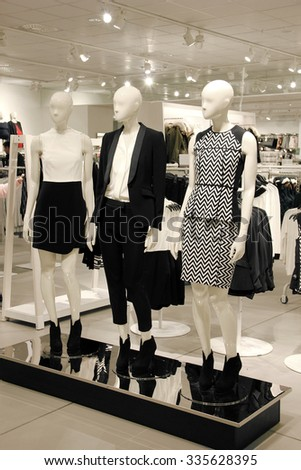 Retail shopping store with mannequins dressed in black and white business clothes