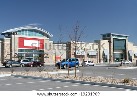 Retail Style Strip Center and Parking Lot - stock photo