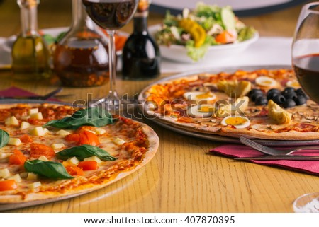 Retaurant ambiente, Pizza italian style, salad, oil, red wine, morzarella tomato and basil olives egg artichokes, Ready to Eat, Food photograghy, diner