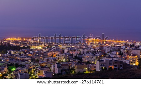 Rethymno cityscape with a harbor at twilight, island of Crete, Greece