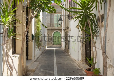 RETHYMNO, GREECE - SEPTEMBER 13. Flowers and Plants in the narrow streets of Rethymno on September 13, 2014. The town is with approx. 50.000 inhabitants the third biggest, and a Tourist Spot on Crete - stock photo