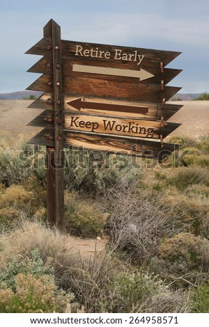 Retire early verses keep working on weathered wooden slats in rural setting - stock photo