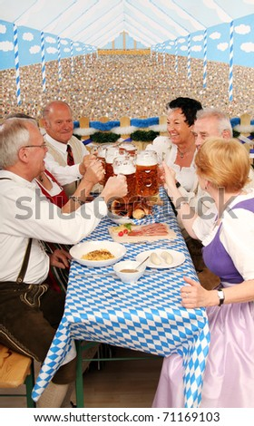 retired bavarian People at Oktoberfest drink Beer - stock photo