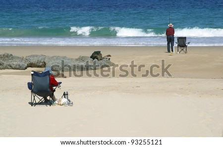 Retired couple at beach - stock photo