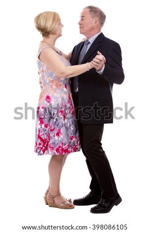 retired couple dressed up on white isolated background - stock photo