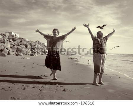 Retired couple on beach series.