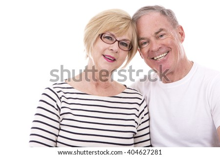 retired couple wearing summer outfits on white isolated background - stock photo