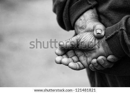 Retired Farmer Crossed Hands of old man who had worked hard in his life