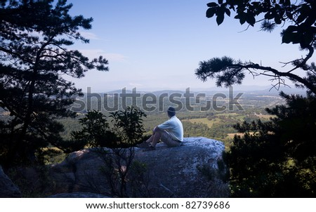 Retired hiker on top of Bull Mountain in Virginia overlooking the valley towards the Blue Ridge and Shenandoah - stock photo