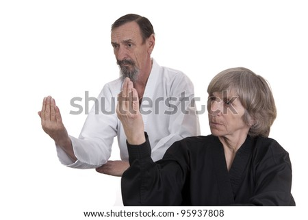 retired man and woman in martial art pose