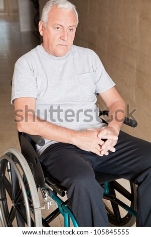 Retired man on wheelchair at hospital.