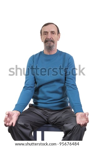 retired man performing chair yoga for seniors