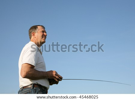 retired man using a radio controller for a model plane