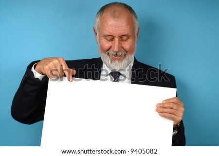 Retired older man holding up poster board that is ready for text - stock photo