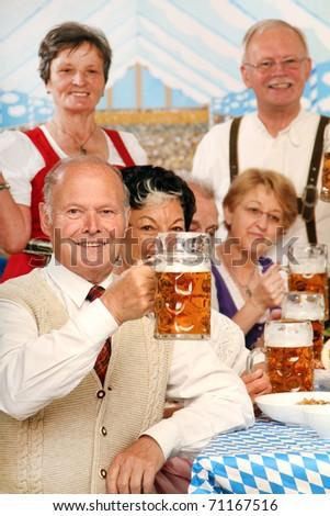Retired People at Oktoberfest - stock photo