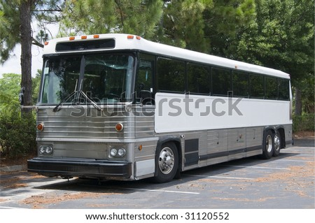Retired tour bus with tinted windows waiting to be sold