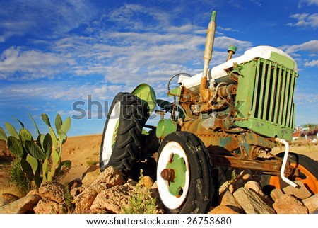 Retired tractor - stock photo