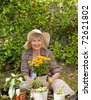 Retired woman working in the garden - stock photo