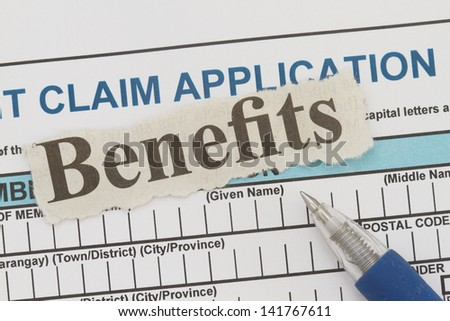 Retirement application form with benefits newspaper cutout. - stock photo